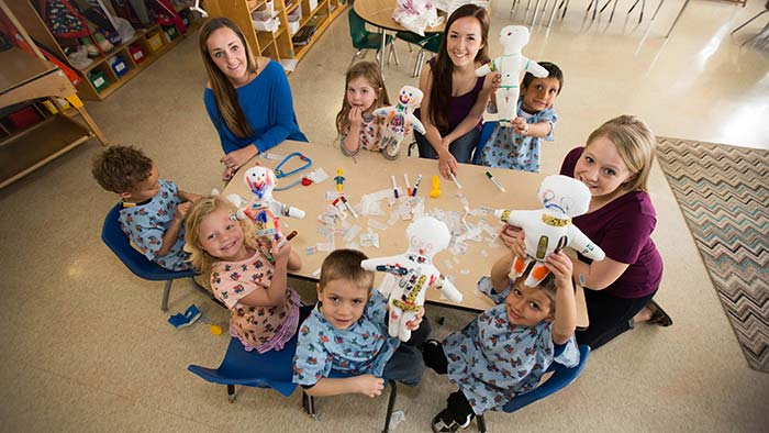Child life majors doing art project with kids