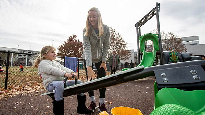 Missouri State student working with kid outside at Child Development Center