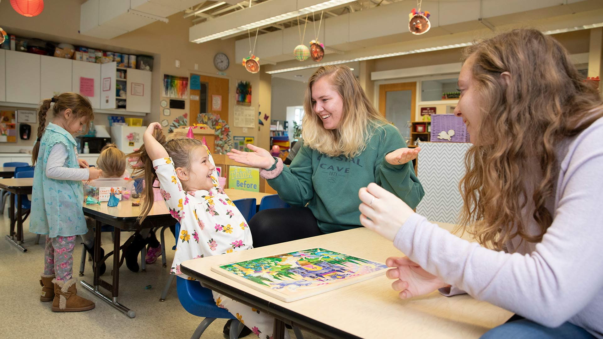 Missouri State students working with young child inside Child Development Center.
