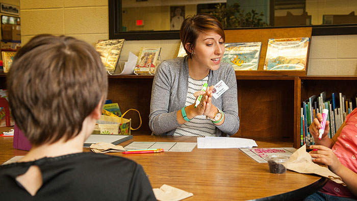 Special education teacher instructing students