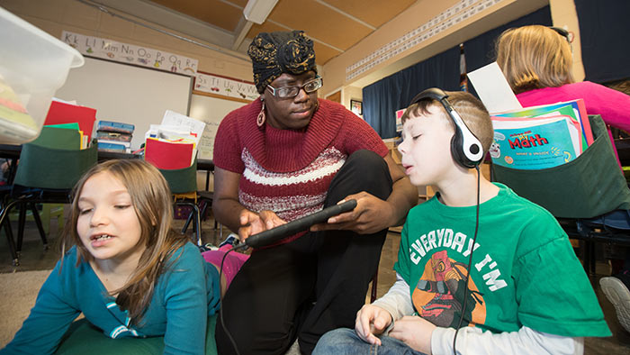 Elementary teacher working with students in classroom